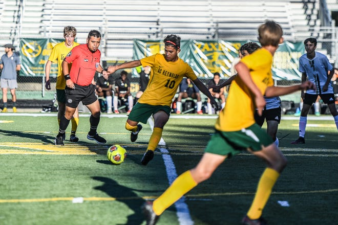 """Reynolds midfielder Moises Diaz (10) had two assists against Asheville on Thursday and is """"carrying"""" the Rockets."""