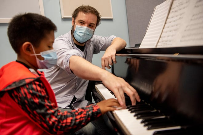 Thomas Vancung Thawng, 8, attends a piano lesson with his instructor Glenn Getty on Thursday, Sept. 23, 2021 The Music Center of South Central Michigan in Battle Creek.