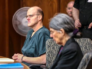 Timothy Haag listens as his attorney gives her opening remarks at the start of his resentencing proceedings in Cowlitz County Superior Court in Longview, Wash., on Jan. 12, 2018.