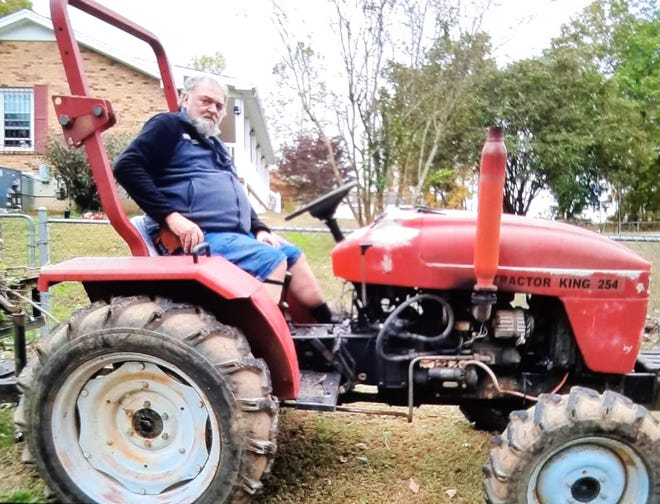 Jim Young poses on his tractor.