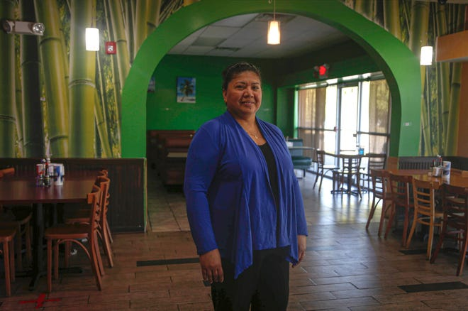 Maura Francisca Merino, a TPS recipient from El Salvador, poses for a photo at El Buen Sabor Latino, a Des Moines restaurant she owns and operates with her husband, on Thursday, Sept. 23, 2021.