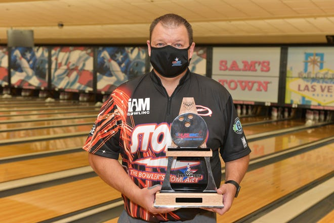 Tom Hess of Granger, Iowa, poses with his trophy after winning the 2021 United States Bowling Senior Masters in Las Vegas.