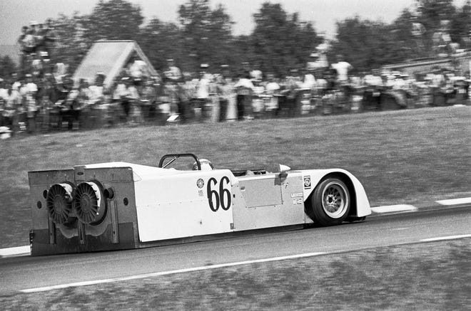 """Watkins Glen Can-Am 1970. Jackie Stewart debuts the Chaparral 2J Ground Effect Vehicle, aka """"the Sweeper,"""" with its 2nd motor that drove two fans to extract air from the interior, thus creating downforce independent of the vehicle speed. This climbing section of the circuit used to be known as """"Graham Hill."""" Photo by Pete Lyons 1970 ©2020 Pete Lyons"""