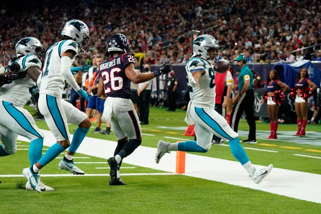 Carolina Panthers tight end Tommy Tremble (82) rushes for a touchdown as Houston Texans cornerback Vernon Hargreaves III (26) defends during the second half of an NFL football game Thursday, Sept. 23, 2021, in Houston.