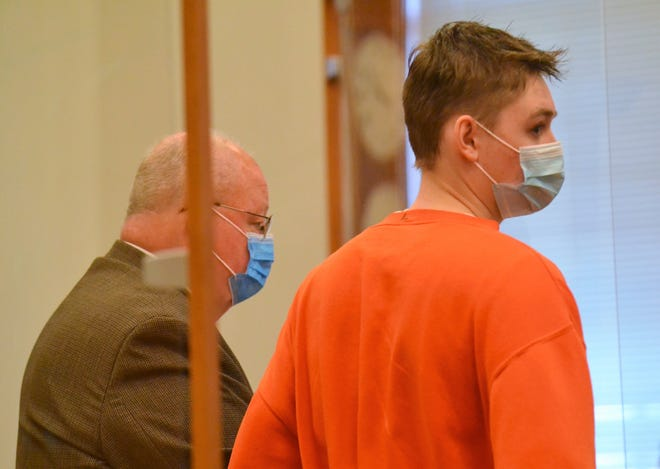 Logan Race, 17, of Oconto, listens to the prosecutor's comments at his sentencing Friday in the shooting of a UP man he was attempting to rob of marijuana last December. HIs attorney, Joseph Klumb, is at left.