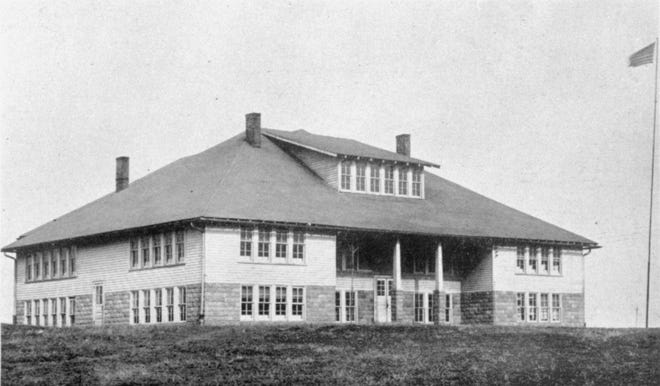 """Smith Mills Consolidated School was erected in 1925 and consisted of 12 classrooms and a combined gym/ auditorium. The school received its accreditation in 1926 and an """"A"""" rating in 1927. It burned in the early morning hours of Sept. 24, 1946. (Photo from the 1929 county-wide yearbook.)"""