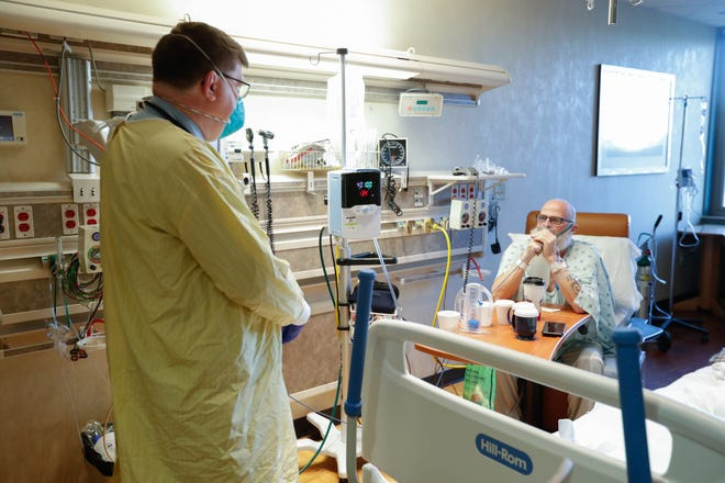 Dr. Robert M. Klinstifer, medical director of pulmonary and respiratory services at Hancock Regional Hospital examines his Covid-19 patient, Mark Green, on Friday, September 24, 2021, at Hancock Regional Hospital, Greenfield Indy.