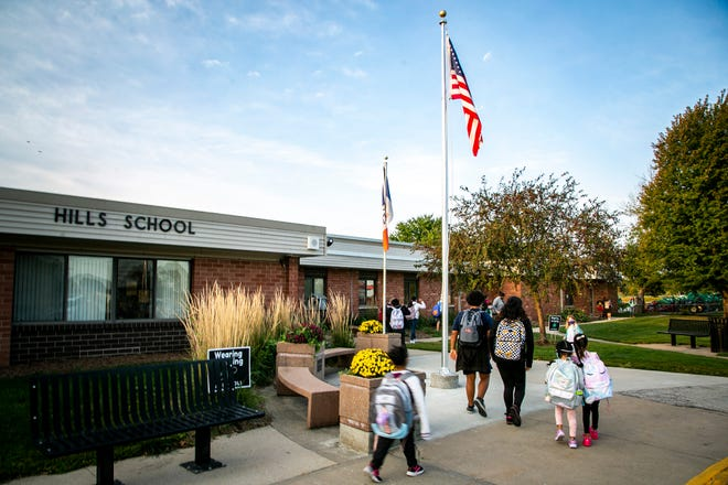 Children arrive at Hills Elementary on Friday, the week the rural Iowa City district school was recognized as one of the nation's best.