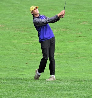 Bloom-Carroll's Michael Whitcraft watches his approach shot on No. 18 during the Mid-State League-Buckeye golf tournament Thursday at Denison Golf Course.