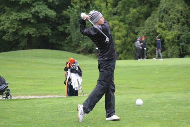Clear Fork's Jared Scott watches his shot during the Mid-Ohio Athletic Conference Boys Golf Tournament on Thursday at the Golf Club of Bucyrus.