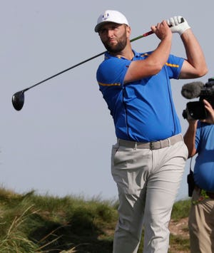 Europe's Jon Rahm watches his tee shot off the 14th hole during the Ryder Cup at Whistling Straits.