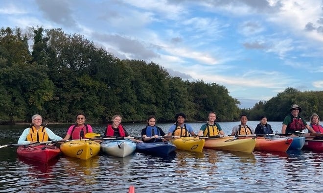 The Rev. John Algera, right, guides a group from New Hope Ministries on the Passaic River in Paterson last on Sept. 21, 2021