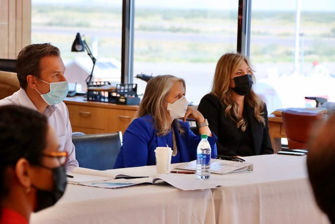 Gov. Michelle Lujan Grisham, center, meets with area business leaders in the Santa Teresa border zone on Friday, Sept. 24, 2021. Next to her is state Economic Development Secretary Alicia Keyes.