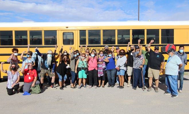 Members of the Las Cruces Transportation Federation Local #6341, the union representing the district's bus drivers, gatherat Student Transportation Specialists of New Mexico in Las Cruces on Friday, Sept. 24, 2021.