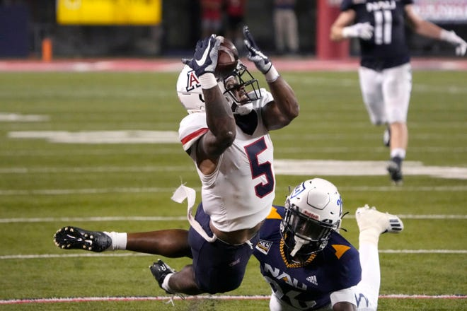 Arizona wide receiver BJ Casteel (5) can not make the catch in front of Northern Arizona defensive back Colby Humphrey during the first half of an NCAA college football game, Saturday, Sept. 18, 2021, in Tucson, Ariz.