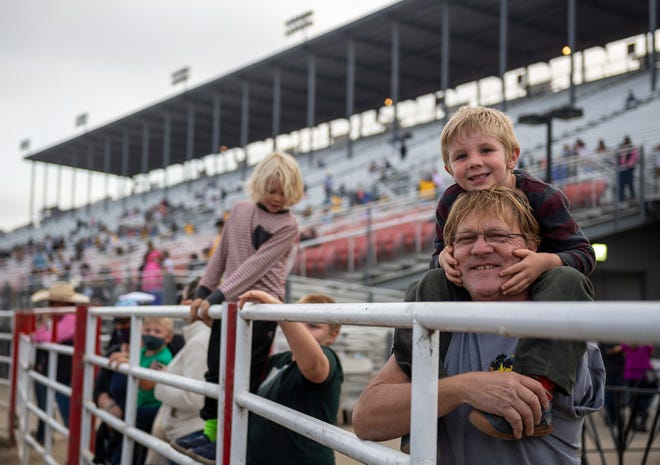 Todd Brammer aka Papa, left, and Stellar Magenheim watch performers prepare inside the Salinas Sports Complex for the California Rodeo Salinas in Salinas, Calif., on Thursday, Sept. 23, 2021.