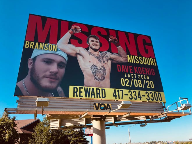 A billboard seeking information about the disappearance of Dave Koenig, 26, stands along U.S. 65 near CC highway in Ozark on Thursday, Sept. 23, 2021.
