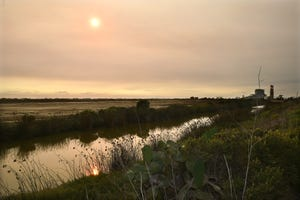 Smoke from wildfires in Central California created an orange haze over the Ormond Beach dunes in Oxnard on Thursday, September 23, 2021.