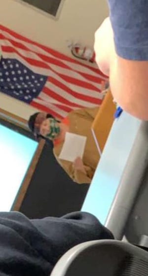 A Wausau West history teacher dressed in Native American attire during a lesson on Wednesday.