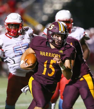 Quarterback Matt Natale (15) has been a central figure in the resurgence of the Walsh Jesuit football program. [Photo courtesy of Tim Howard]