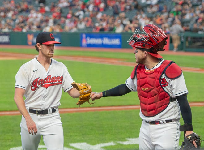 Cleveland starting pitcher Shane Bieber gets a fist bump from Roberto Perez after getting the Chicago White Sox's out during the first inning of a baseball game in Cleveland, Friday, Sept. 24, 2021. Bieber, sidelined with an arm injury is making his first start since June 13. (AP Photo/Phil Long)