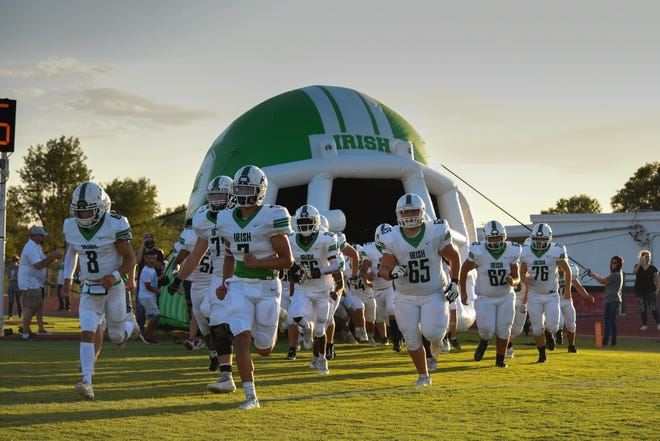The Shamrock Irish football team enter the field ahead of the game against Gruver on Friday, Sept. 24, 2021, at Greyhound Stadium.