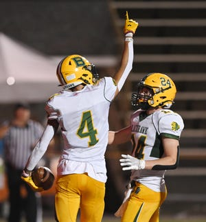 Blackhawk's Lorenzo Jenkins celebrates his touchdown with teammate Zach Ours during Friday night's game at Ambridge High School.