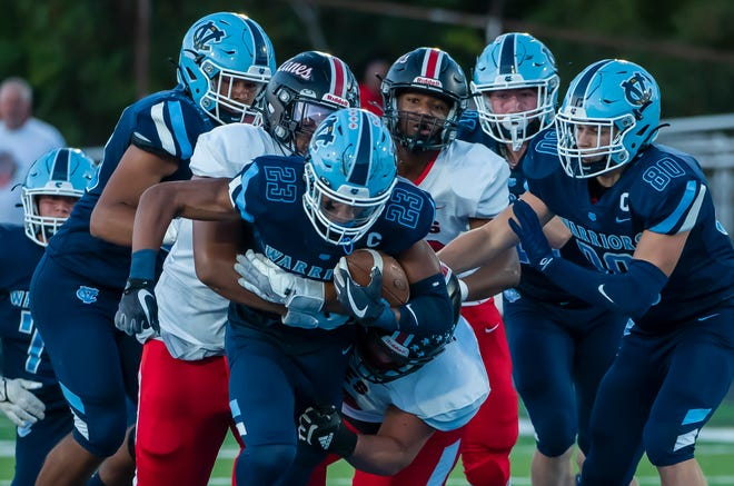 Central Valley's Landon Alexander pulls several New Castle players with him in the first quarter of their game Friday at Sarge Alberts Stadium. [Lucy Schaly/For BCT]
