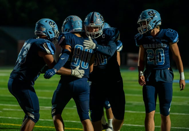 Central Valley's Jack Bible is congratulated by his teammates after he scores a touchdown against New Castle during the 2nd quarter of their game last month at Sarge Alberts Stadium. [Lucy Schaly/For BCT]