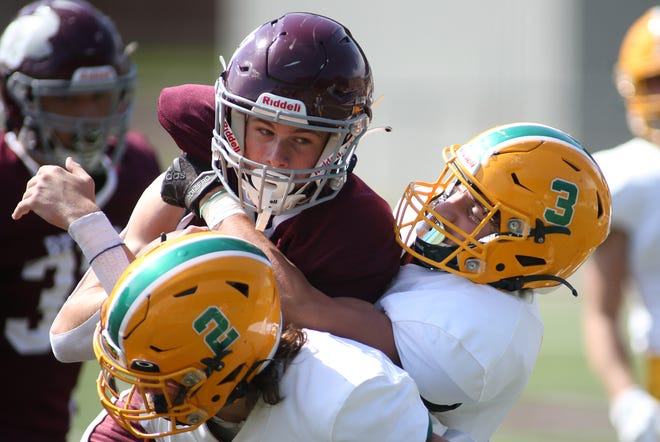 Beaver quarterback Wyatt Ringer (21) gets tackled by Seton LaSalle's O'Malley Daly (3) during the first half Saturday afternoon at Beaver Area High School.