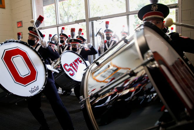 Members of the Ohio State University Marching Band drumlins perform for fans as they enter St. John Arena for Skull Session before a NCAA Division I football game between the Ohio State Buckeyes and the Akron Zips on Saturday, Sept. 25, 2021 at Ohio Stadium in Columbus, Ohio.