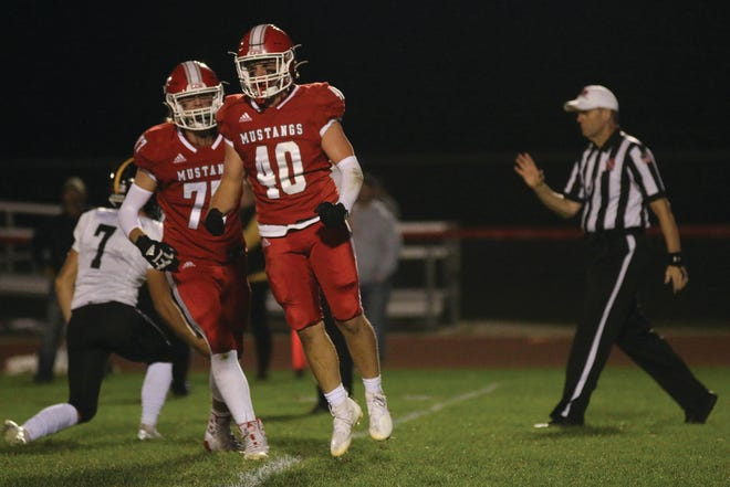 DCG's Spencer Hall celebrates a sack against Winterset during the Mustangs' homecoming game with the Huskies on Friday, Sept. 24, 2021, in Grimes.