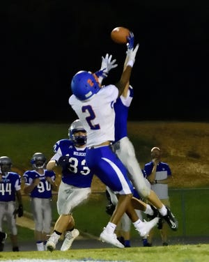 A pass intended for Lexington's Tevvohn Knots is deflected by South Davidson's Seth johnson. [David Yemm for The Dispatch]