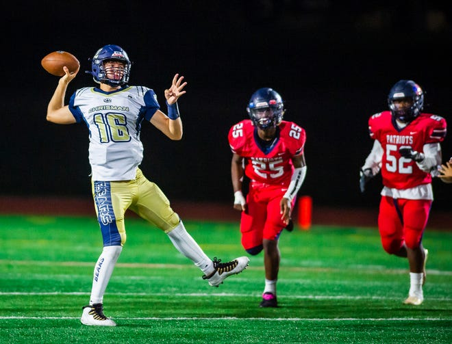 William Chrisman quarterback Dayne Herl throws a pass down field while scrambling away from a pair of Truman defenders in Friday's game at Truman. Chrisman topped the host Patriots 50-0 for its seventh straight win in the Noland Road rivalry series.