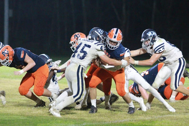 Ascension Christian's Ethan Hunt is taken down hard in the Lions' 42-21 loss to Westminster.