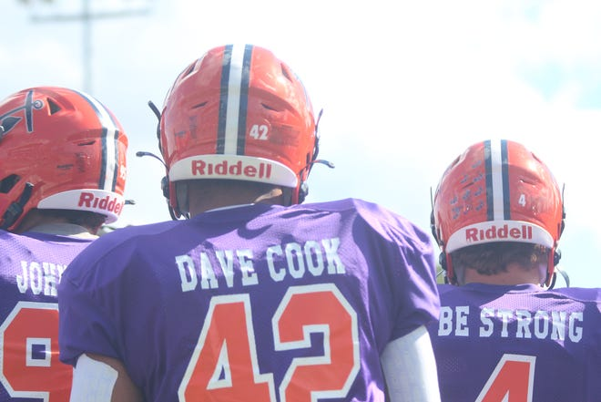"""Hope linebacker Marcus Arens wears """"Dave Cook"""" on his jersey to honor head coach Peter Stuursma's father in law who recently passed away"""