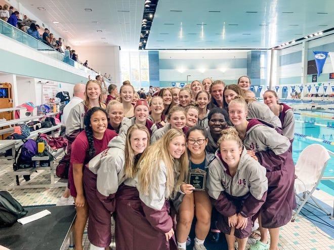 Holland Chrisitan girls swimming team celebrates their win