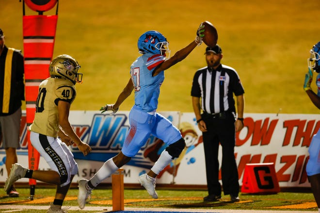 Monterey's Kashious Lewis (17) scores a touchdown during the first half of the team's high school football game against Lubbock on Friday, Sept. 24, 2021 at Lowrey Field in PlainsCapital Park in Lubbock, Texas.