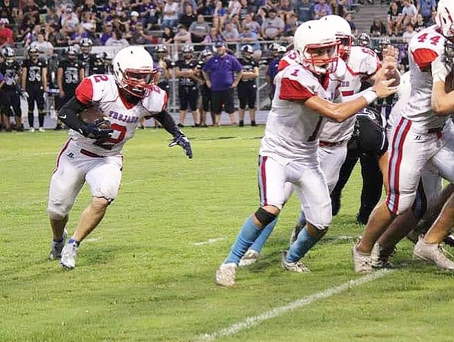 EBHS running back Kane Atkinson (2) rushed for 150 yards and three touchdowns in the Trojans' 64-50 win on Friday over the Elton Indians.
