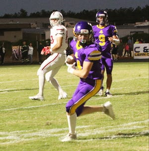 South Beauregard's Bryce Deason heads up the field after feeling in a pass during the Golden Knights' loss to Dunham on Friday, 49-0.