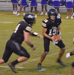 Leesville quarterback Parker Maks (15) hands the ball off to Layne Self during a recent Wampus Cat win. Maks had a combined four touchdowns on Friday in a 35-32 Leesville loss to Pineville.