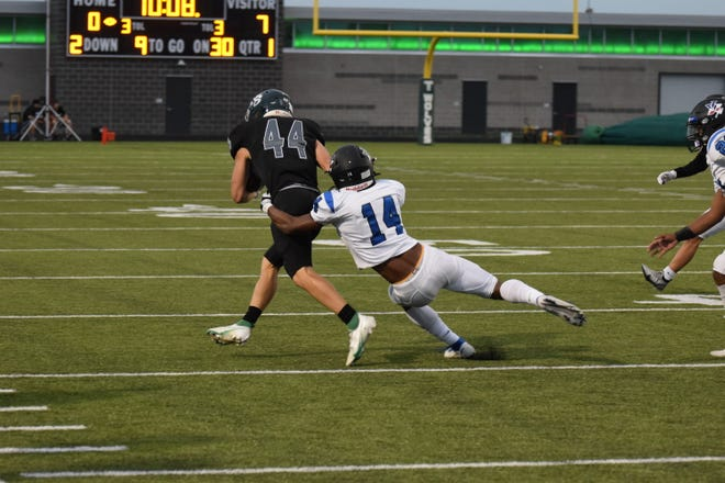 Shown is Leavenworth defensive back Michael Mejia tackling a Blue Valley Southwest receiver during Friday's 28-21 loss.