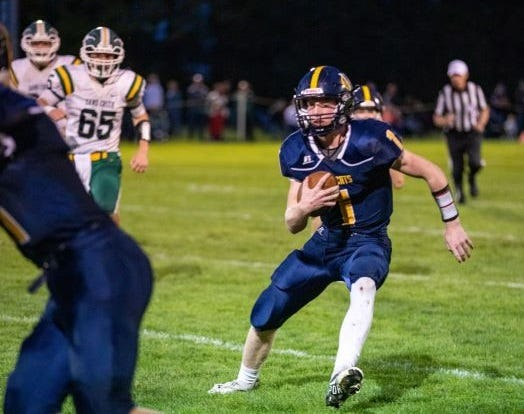 Shea Ruddy runs the ball for Whiteford Friday night. Ruddy threw for three touchdowns and ran for one as the Bobcats beat Sand Creek 58-30.