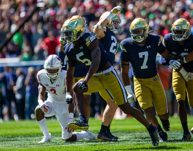 Notre Dame's Cam Hart (5) celebrates an interception during the Notre Dame vs. Wisconsin NCAA football game Saturday, Sept. 25, 2021 at Soldier Field in Chicago.