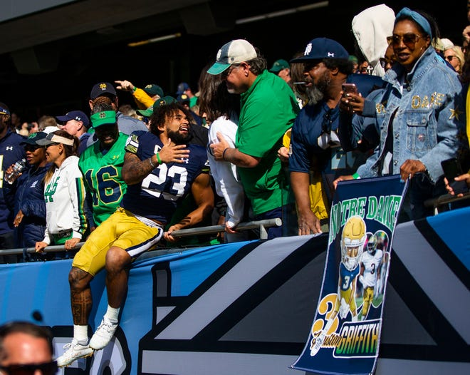 Notre Dame running back Kyren Williams (23) celebrates with fans after ND's 41-13 win over Wisconsin, Saturday, Sept. 25, 2021, at Soldier Field in Chicago.