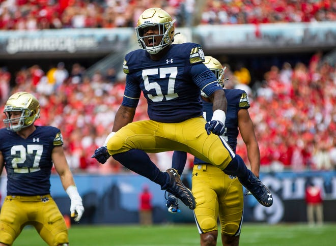 Notre Dame's Jayson Ademilola (57) celebrates during ND's 41-13 victory over Wisconsin, Saturday, Sept. 25, 2021 at Soldier Field in Chicago.