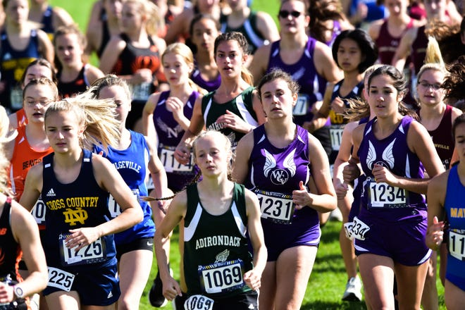 Varsity runners compete in the 78th EJ Herrmann Invitational on Saturday, Sept. 25, 2021 at Thomas R. Proctor Park in Utica.