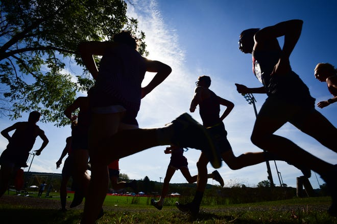 Varsity boy runners compete in the 78th EJ Herrmann Invitational on Saturday, Sept. 25, 2021 at Thomas R. Proctor Park in Utica.