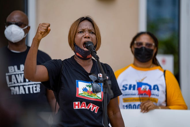 Anne Pierre speaks during a protest of the treatment of Haitian refugees who are gathered at the US-Mexico border. Speeches, prayers and chants for justice were spoken at the rally in West Palm Beach, Florida on September 25, 2021. GREG LOVETT/PALM BEACH POST