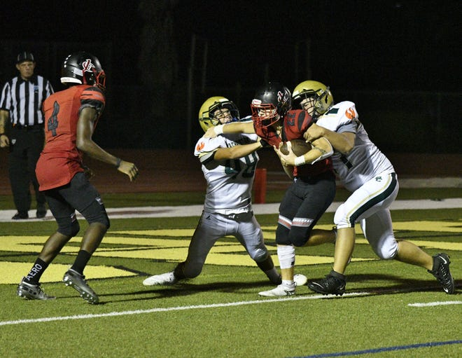 Junior Alex Rosario of Jupiter Christian runs in a two-point conversion on a fake PAT. Even late in the game, the Eagles were looking for ways to push their creativity to new levels.